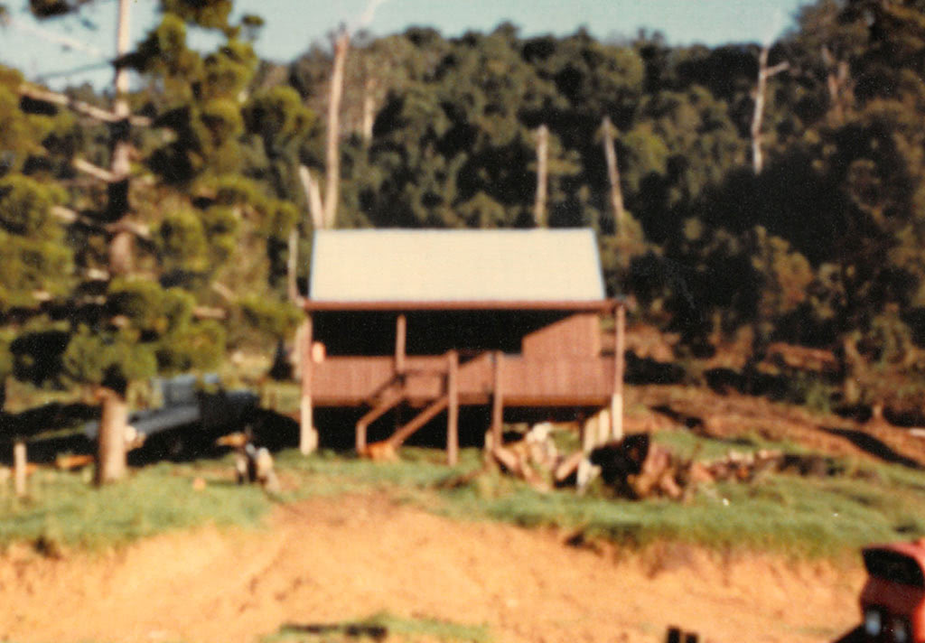 First Construction Project, Carrai-1983, by Peter Moroney Building Certifier. Timber Cabin, Motorbike, Grassy Hill, Trees,